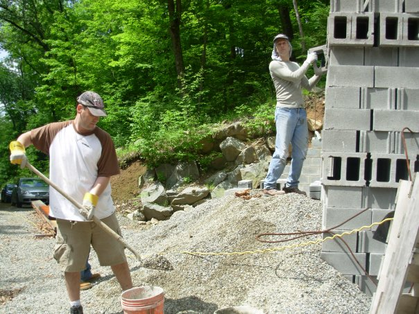 Jeff Bender makes concrete; Jim Reilly hauls block.