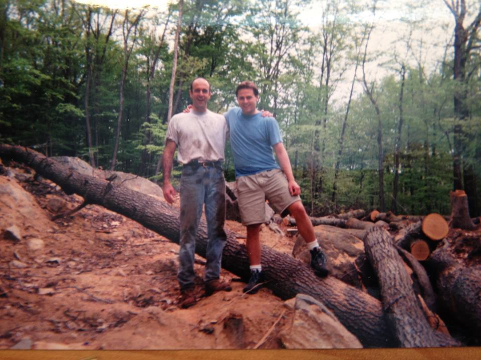 """Tree clearing. The trees are """"dropped;"""" Jim Reilly and Joe Discher are ready to cut them up."""