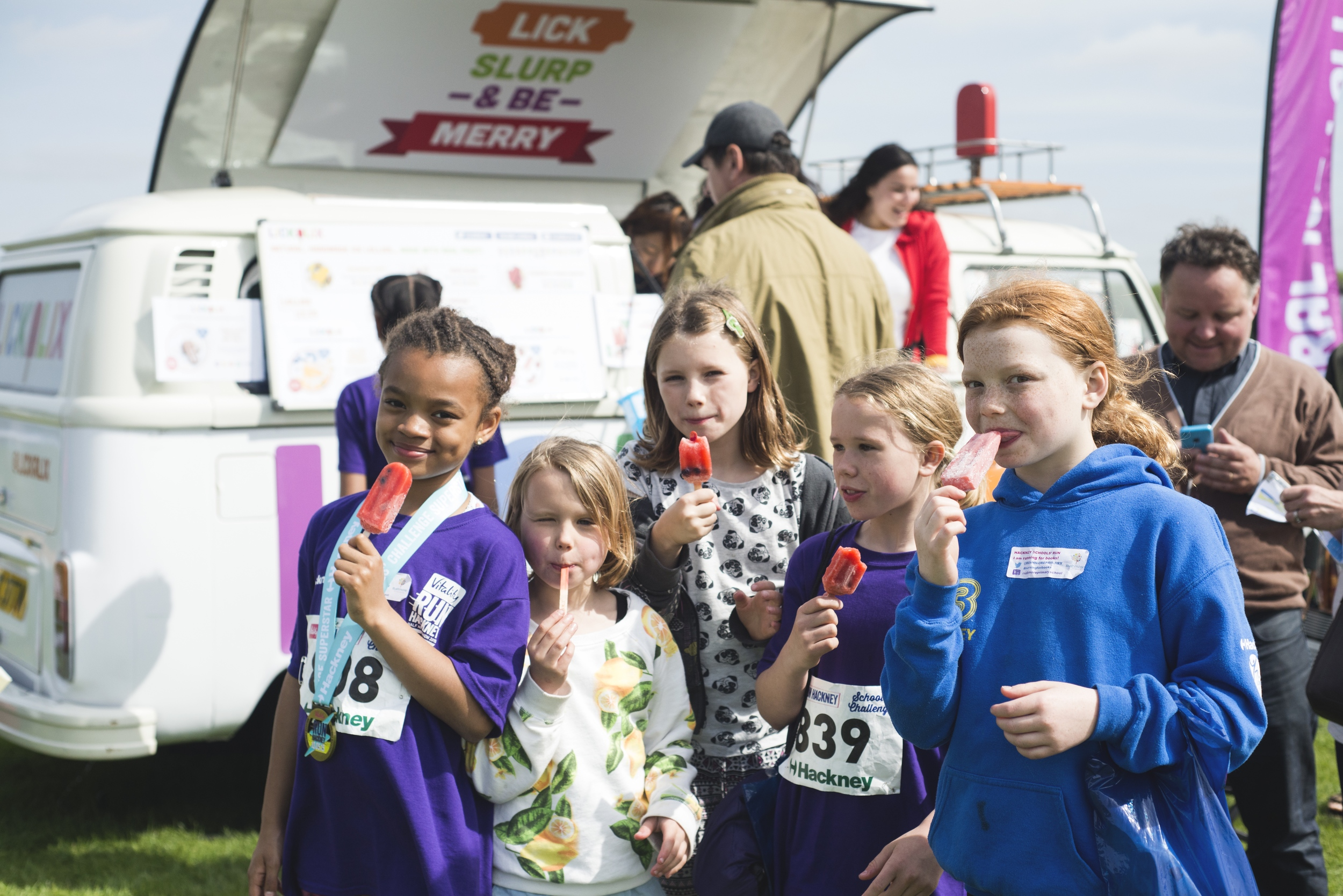 The young athletes enjoying their fruity lollies