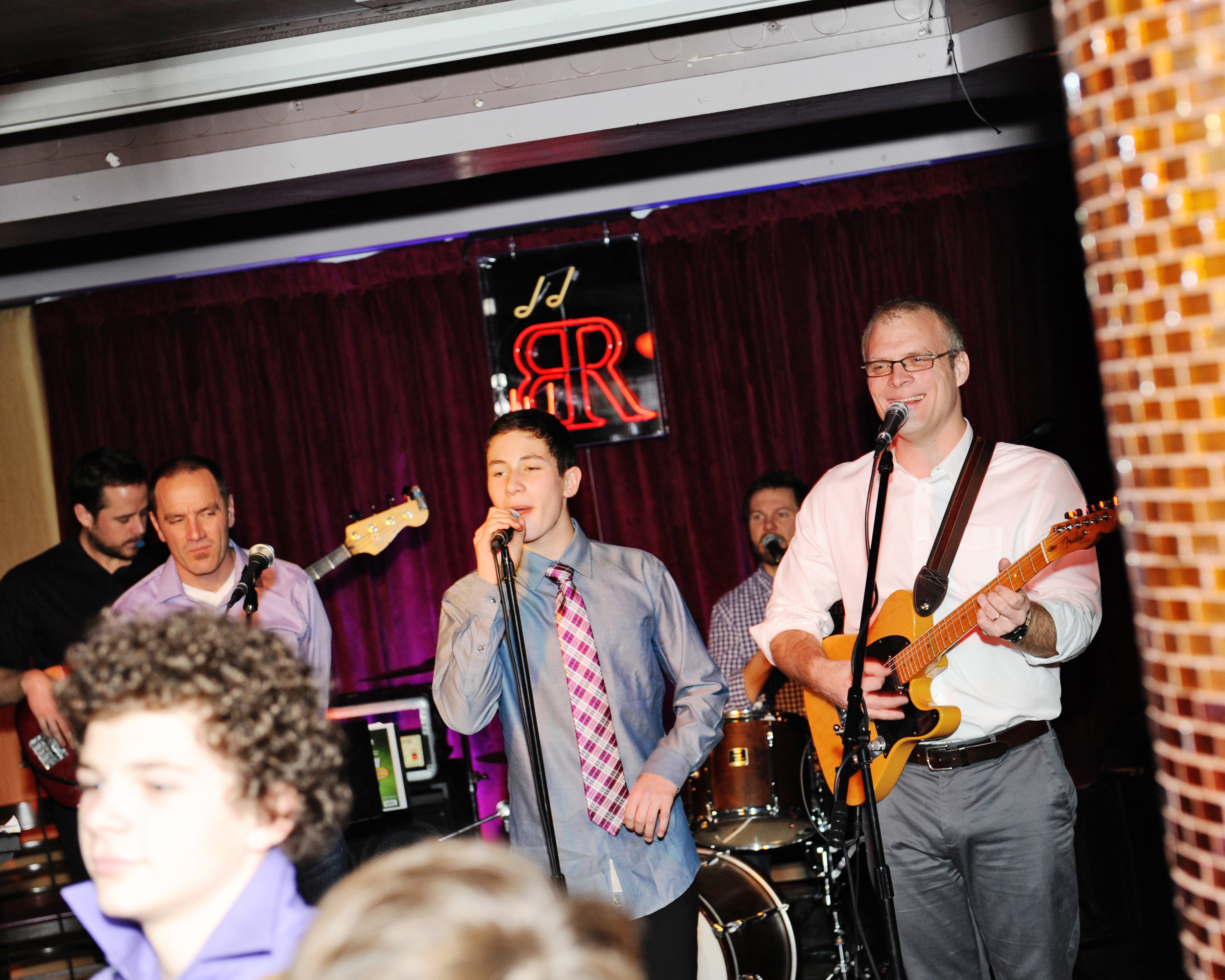 Bar Mitzvah'd lad rockin' with the band. Photo courtesy of  g-gphoto.com .