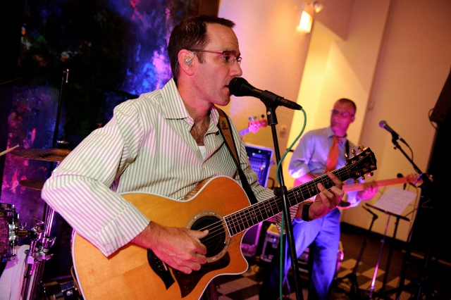 Jim sings at a corporate shindig. Photo courtesy of Darcy Demmel Photography.