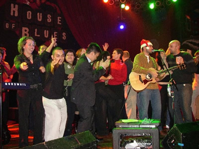 Things get a bit crazy when some of the UBS staff joins us on stage at their holiday party at the House of Blues.