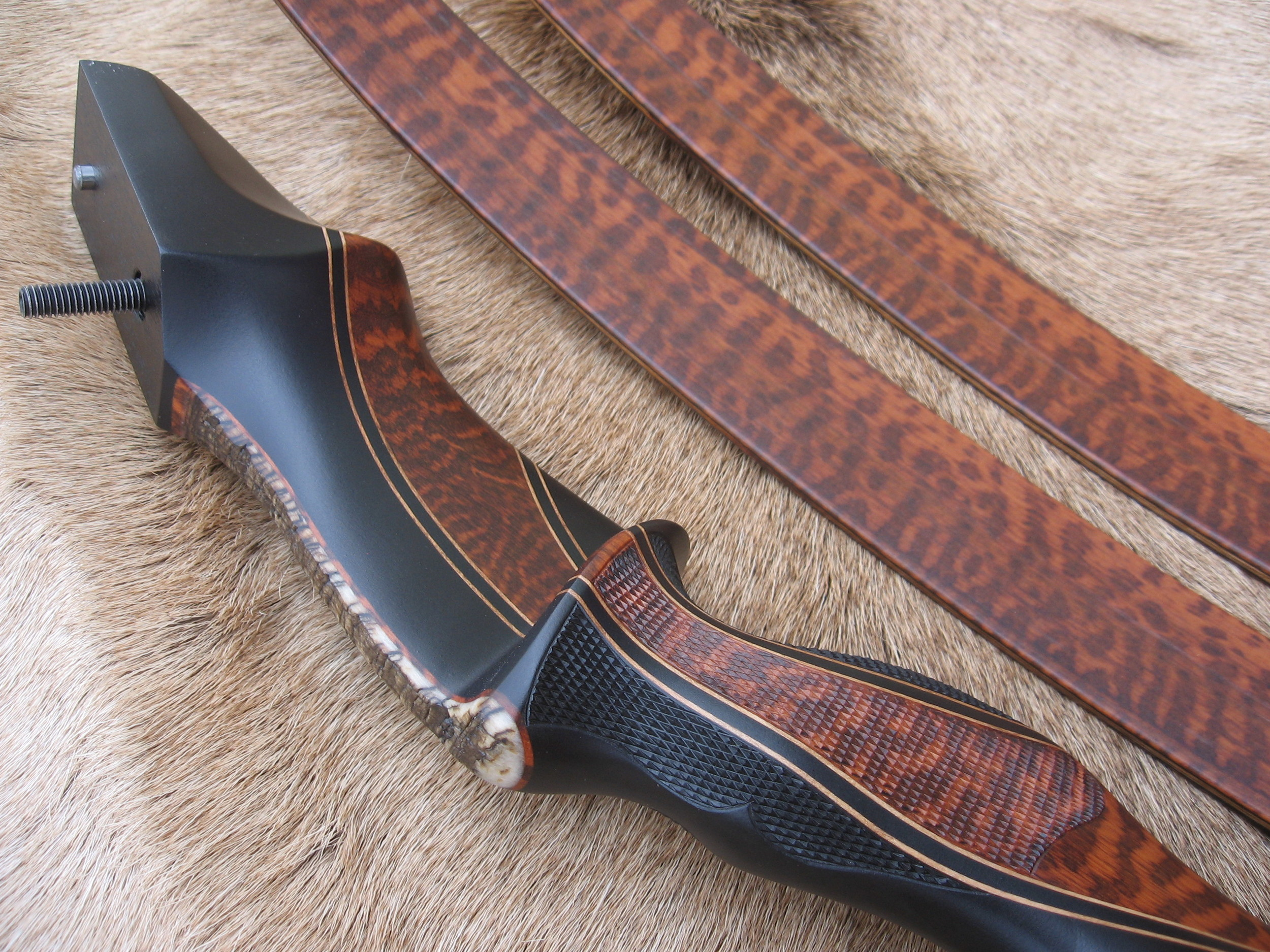 Gaboon Ebony Riser w/ Snakewood Crescent and rough Sheep Horn overlay- Snakewood Limbs