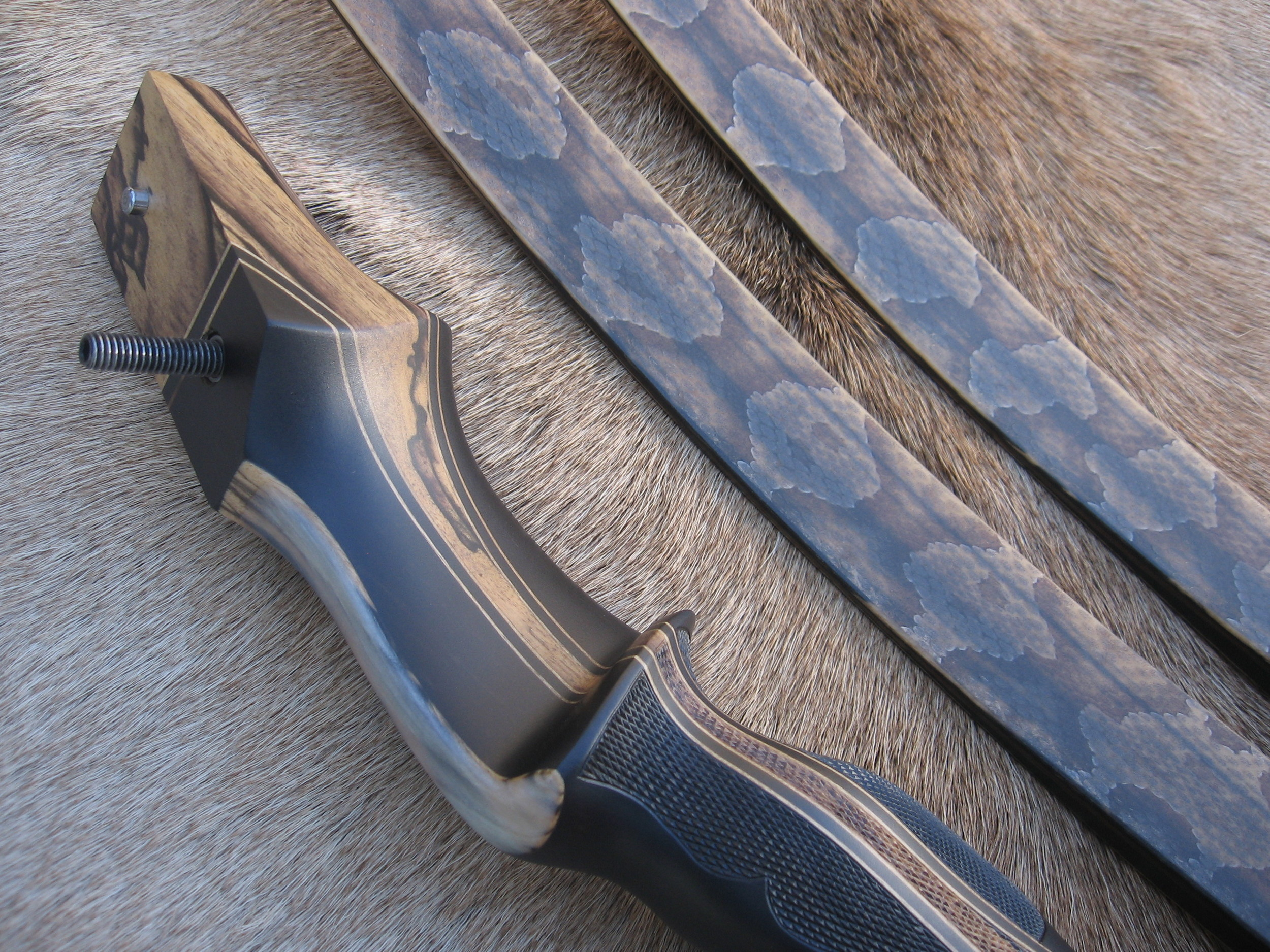 Macassar Ebony Riser w/ Black and White Ebony Flare and smooth Sheep Horn overlay- Copperhead skins