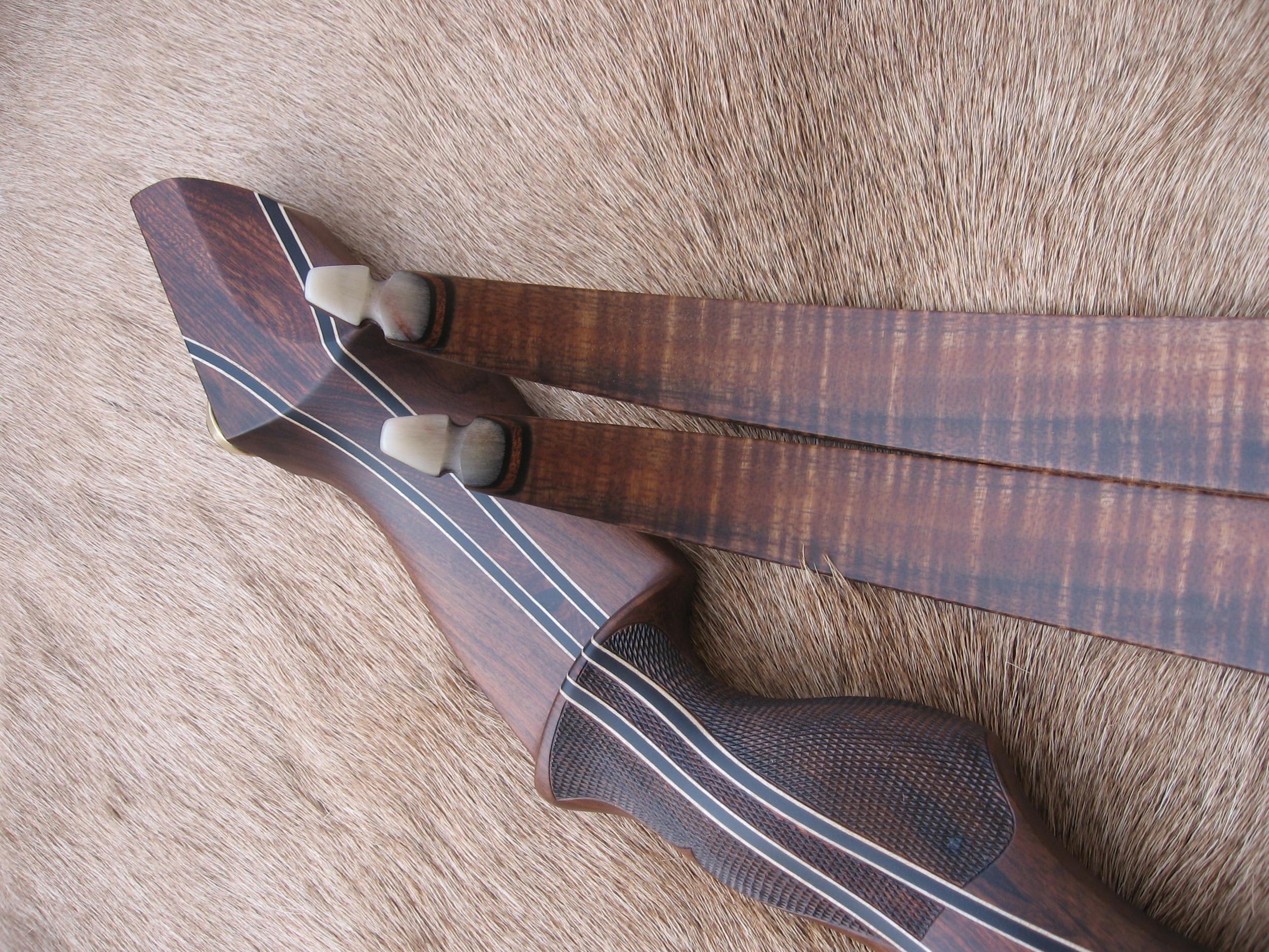 Santos Rosewood Riser- Curly Koa limbs, smooth sheep horn tips
