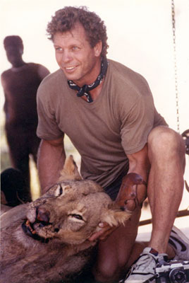 Paul Schafer with African Lion which he shot to save his guides life.