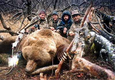 From left to right: Paul Schafer, Jeff Boothe, Brad Adams and Bart Schlayer. Kodiak bear taken by Bart Schlayer in the fall of 1992. One of Paul's last big hunts.