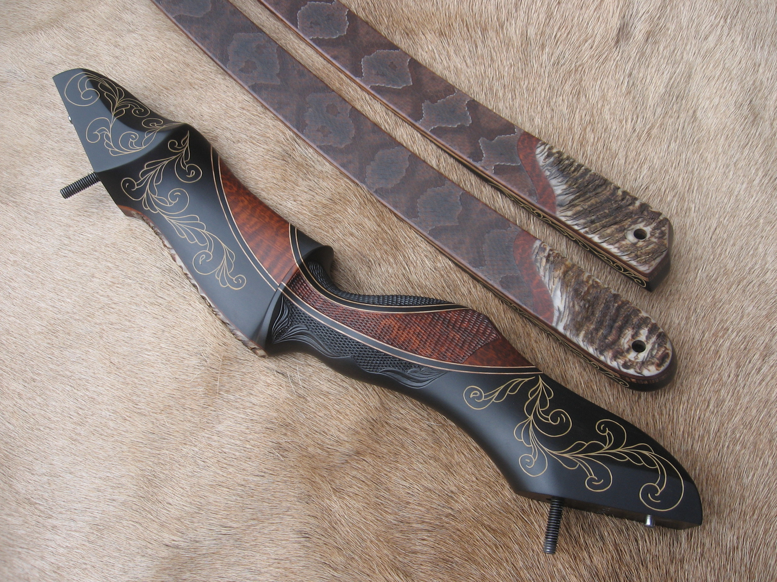 Gaboon Riser, snakewood crescent, hand carved scrolling. Call or e-mail for quote.