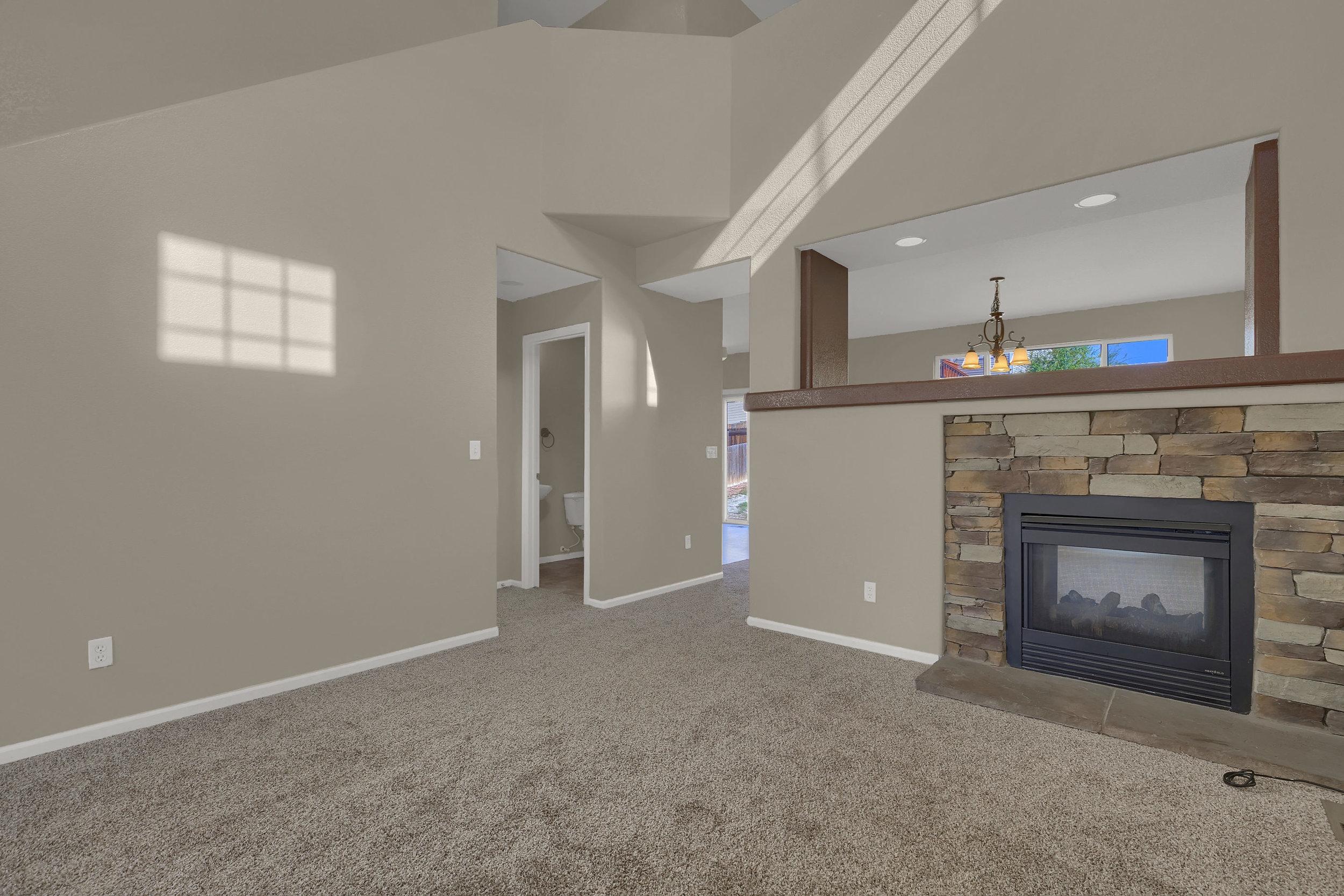 7584 Dobbs Drive Fountain CO-print-004-1-Living Room-2799x1867-300dpi.jpg