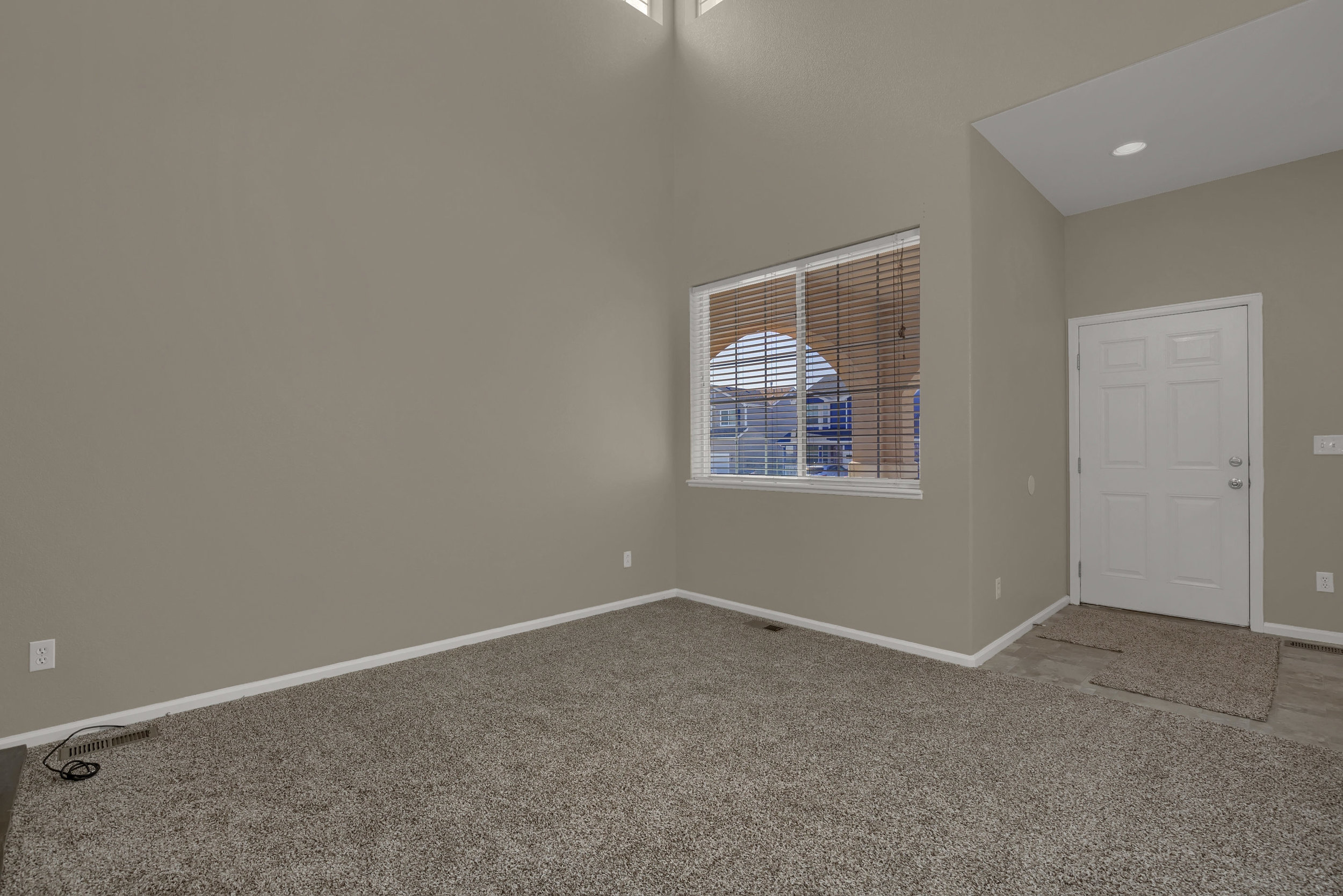 7584 Dobbs Drive Fountain CO-print-005-3-Living Room-2799x1867-300dpi.jpg