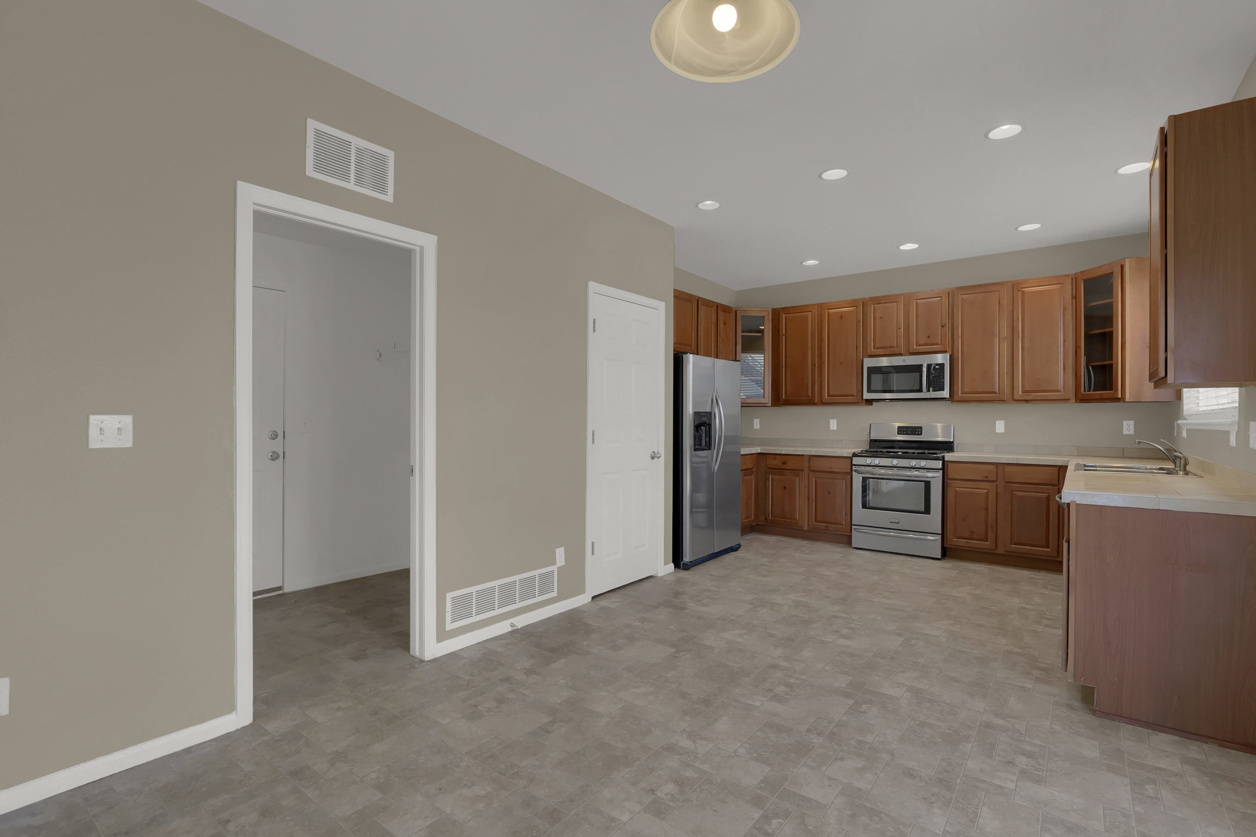7584 Dobbs Drive Fountain CO-print-012-10-Kitchen-2800x1867-300dpi.jpg