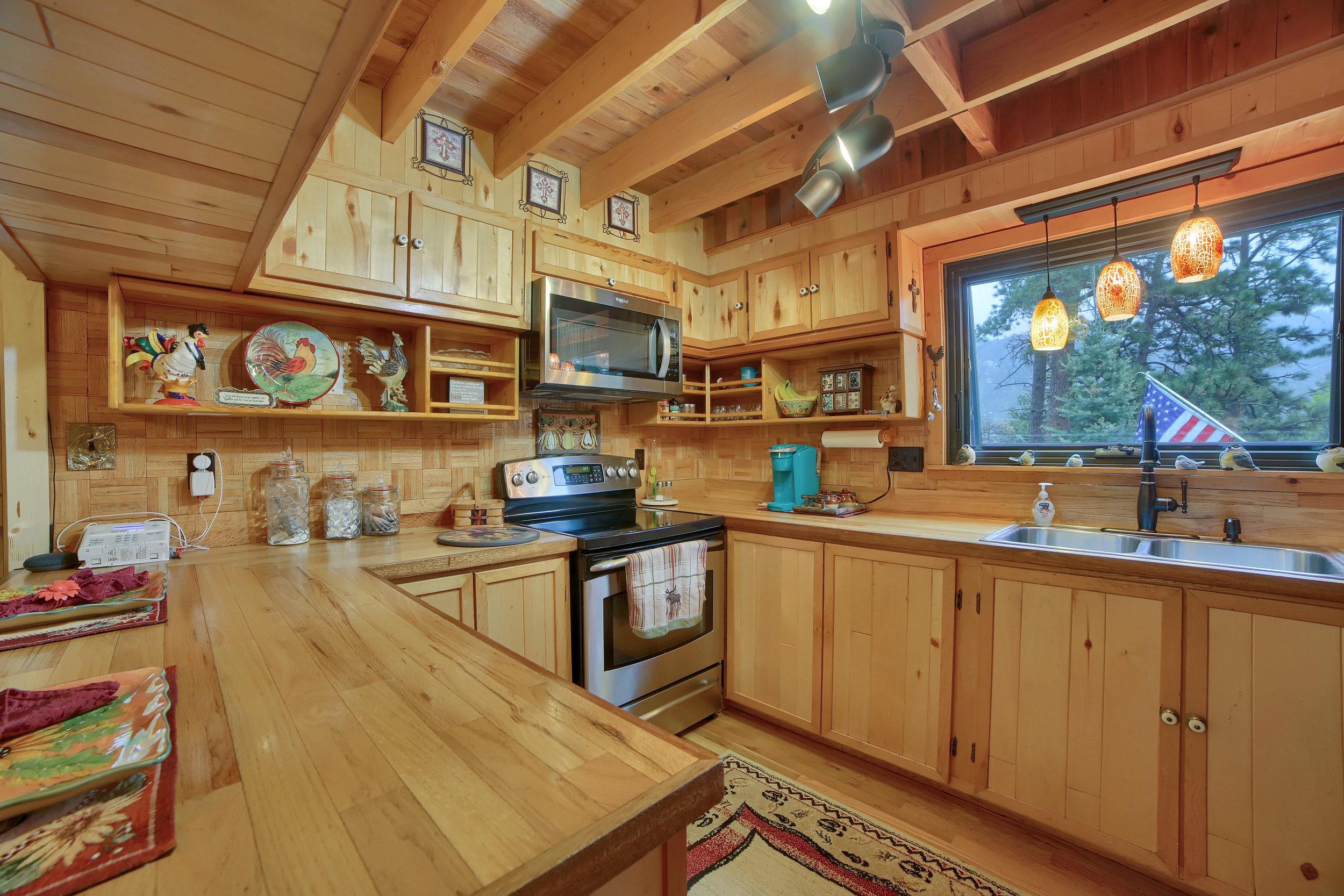 9770 Mountain Road Cascade CO-print-009-14-Kitchen-3648x2432-300dpi.jpg