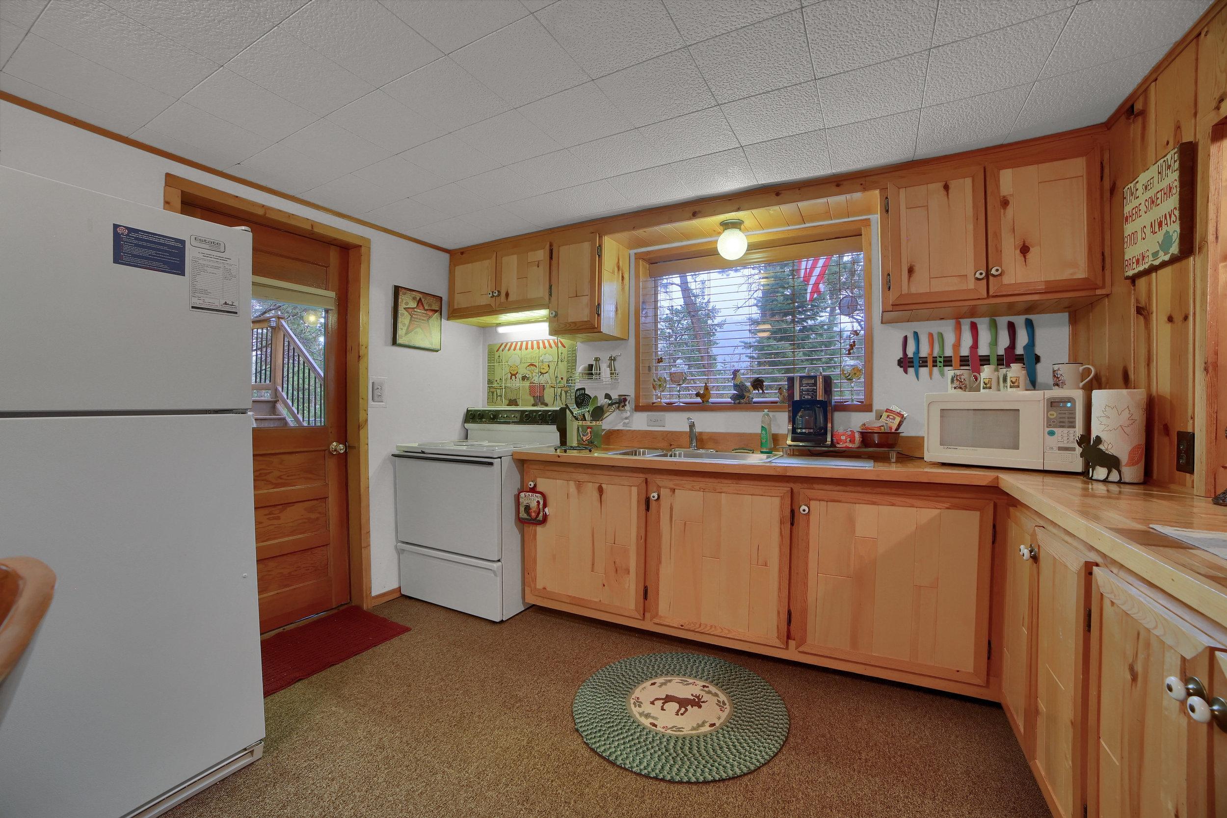9770 Mountain Road Cascade CO-print-019-24-Kitchen-3648x2432-300dpi.jpg