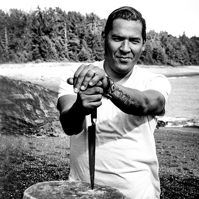 "#BlackandWhite #outtakes from @toqueandcanoe assignment in #Yuquot, as guests of the #Mowachaht-Muchalaht First Nation.  Last fall, @aboriginalbc invited Top Chef Canada finalist Rich Francis @7thFire and movie star Duane Howard of ""The Revenant"" to a remote island off the west coast of Vancouver Island to film three video shorts for their 2017 marketing campaign about Indigenous culture in Yuquot.  I travelled to Yuquot (still currently known more widely by its settler name of Friendly Cove) as a guest of Aboriginal Tourism BC with Kim Gray on assignment for @toqueandcanoe, Kim's award-winning online travel magazine about Canadian travel culture.  It was exciting to follow Rich—who had never been to this part of BC—as he smelled, tasted, picked, plucked, pulled out of tidal pools, chopped and lit a fire under all kinds of wild-growing plants, shellfish and salmon and served them up with the help of Ray and Terry Williams—Yuquot's only permanent Mowachaht-Muchalaht residents since the community was relocated to Gold River in the '70s.  All this bounty was found within a few hundred metres of the cabin where he set up to get inspired and cook for three days.  Chef Francis, originally from the Northwest Territories and a member of the Tetlit Gwich'in and Tuscarora Nation, is founding chef of The Seventh Fire Hospitality Group Inc. He describes his approach to cooking and feeding people as a way to achieve truth and reconciliation by de-colonizing Aboriginal food.  About Yuquot, he tells Kim: ""It's rough here, like me. Freestyle, not polished."" Read Kim's story, ""Feeding our spirits in Yuquot, BC"" here: http://ow.ly/r9Ig30dI2Rx  Look for the link at the bottom of the blog post to the three ""Indigenous British Columbia"" videos shot and produced by Danny and Ryan of @blackrhinocreative.  @hellobc @aboriginalcanada  #FriendlyCove #indigenous"