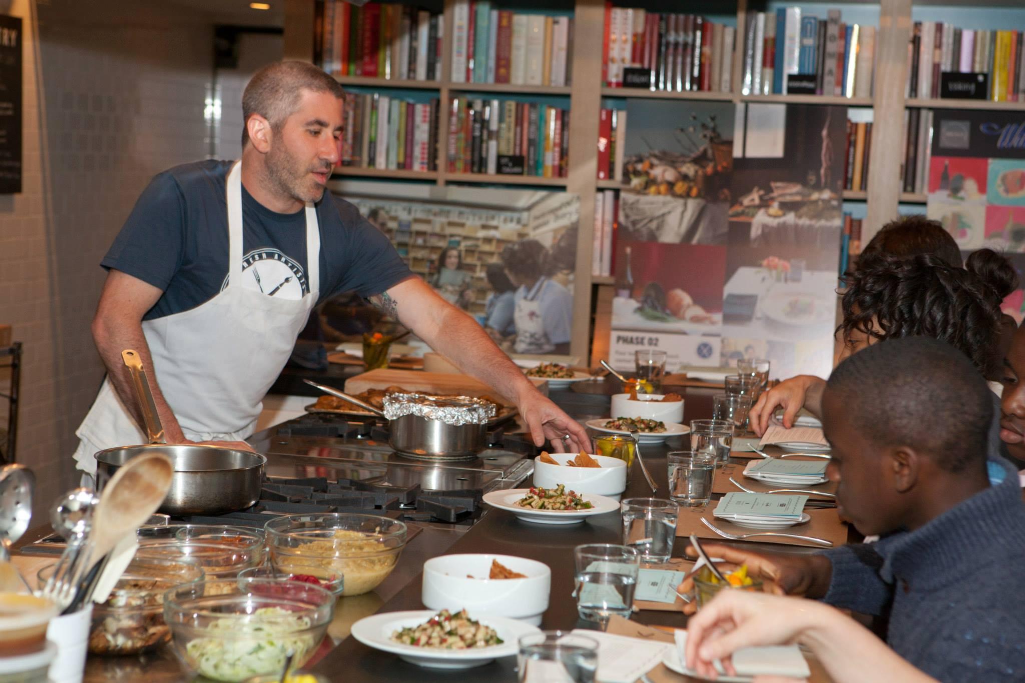 "Michael Solomonov explaining salatim and hummus to the ""Chef's Choice"" winners."