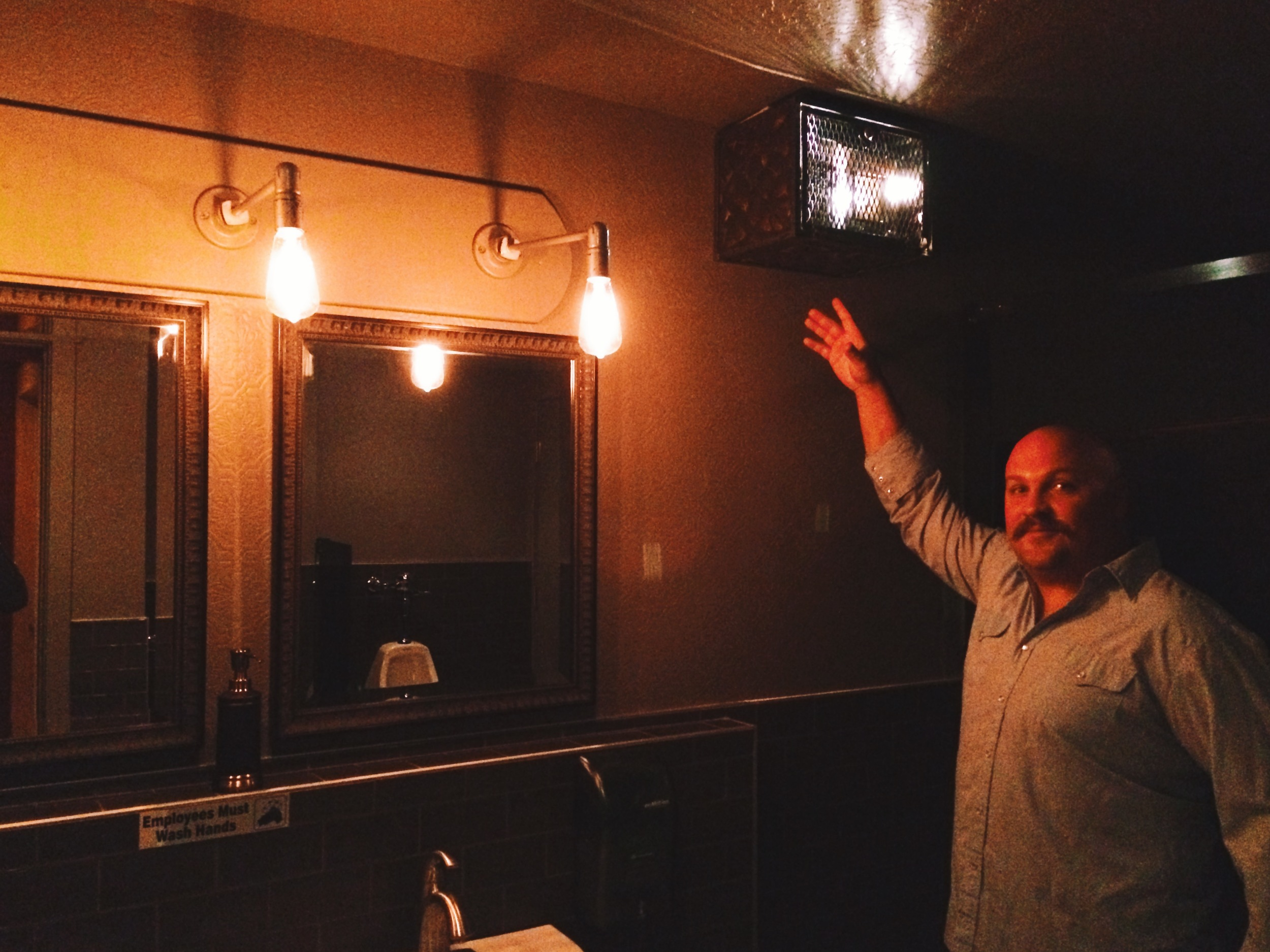 Bathrooms house vintage radio's that play old time shows like The Lone Ranger, curated by Johnny Peppinger.