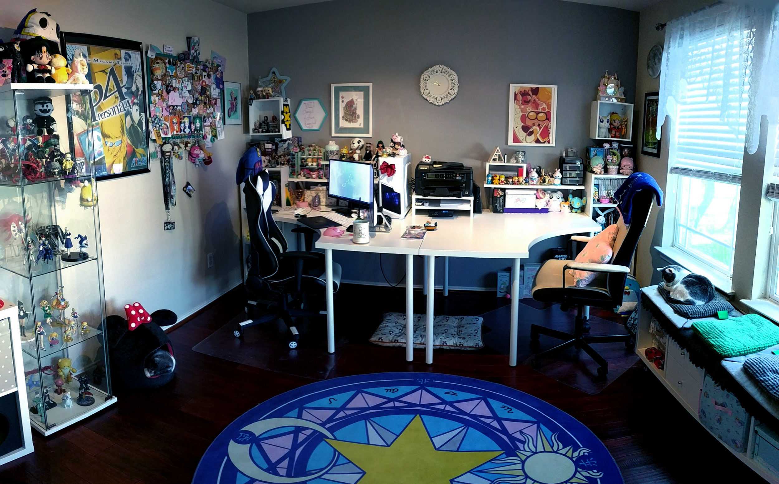 This is my home office where I work surrounded by the things that inspire me. Also pictured are my cats, Porkchop and Mochi.