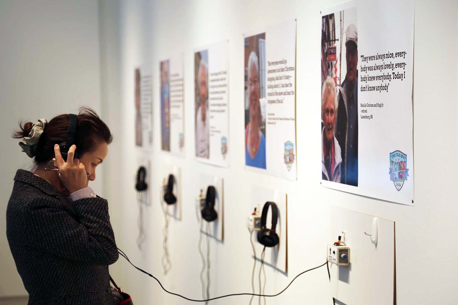The Tale of a Town Oakville Interviews' Audio Listening Wall Station with Audience Member
