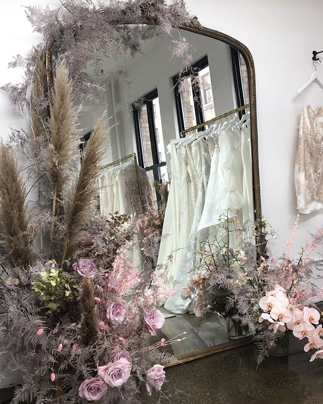 ☁️✨Dreamland ✨☁️ The floral installation at the @alexandragrecco studio always sets the stage for something magical 💫 Swipe for some of our favorite looks from her recent presentation at #newyorkbridalweek 🌙 #agxmoonstone #ceremonygoestomarket @amorosa5nyc