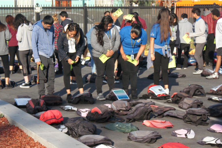 """Some of Alliance Neuwirth Leadership Academy's 600 students viewing the MSMF-sponsored """"Send Silence Packing"""" teen suicide prevention exhibit from Active Minds."""