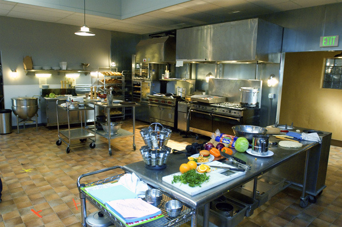 """Lava Springs Country Club kitchen stage set built for the """"Work It Out"""" dance number."""