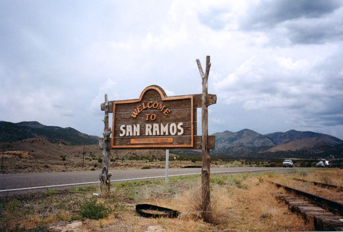 Tattered town sign for the once proud, now dying border town of San Ramos.