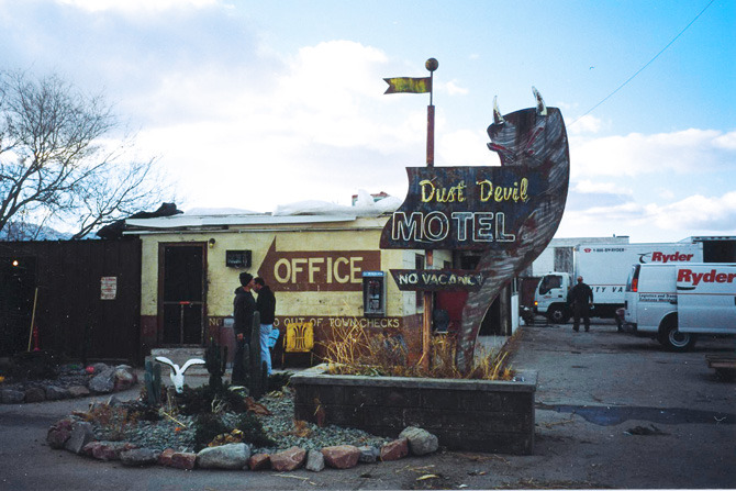 Dust Devil Motel sign build and exterior dress of a seedy and remote desert motel.