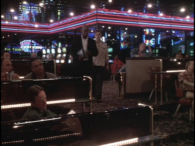 Edward (Ron Eldard) and 477 (Bokeem Woddbine) enter the sports book casino stage set.