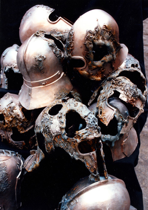 A pile of rotting helmets.