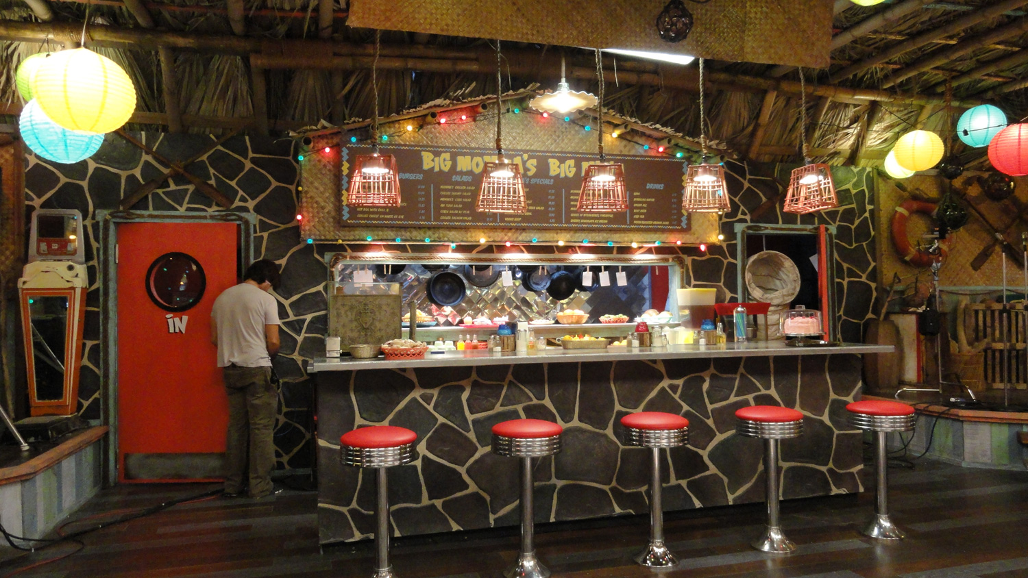 A detail shot of the kooky lava lunch counter and kitchen/pass through in Big Momma's interior.