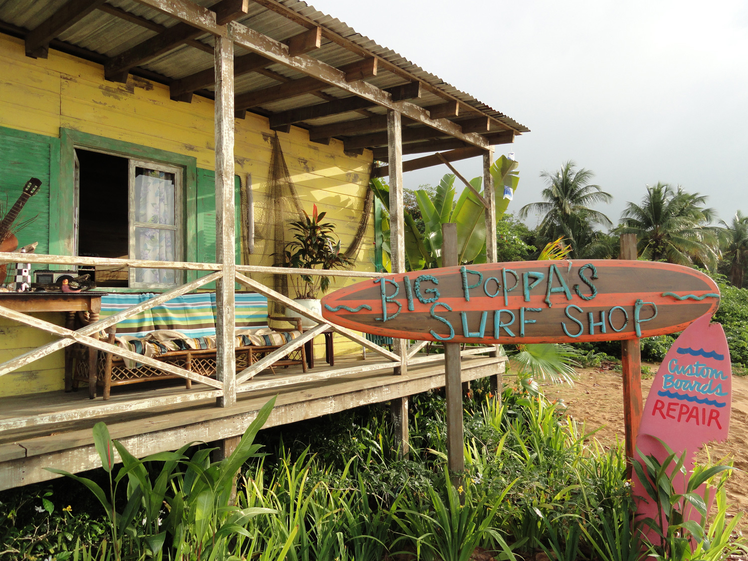 A detail shot of Big Poppa's (Barry Bostwick) surf shop. We built this interior/exterior set right at the high-tide line on a cove in eastern Puerto Rico. This way our kids could run out the front door, grab their boards and jump right into the surf.