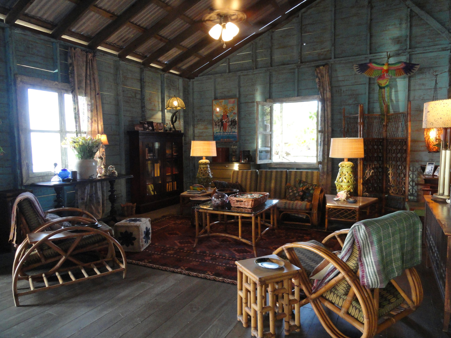 A reverse shot showing the casual living room in Big Poppa's surf shop/house.