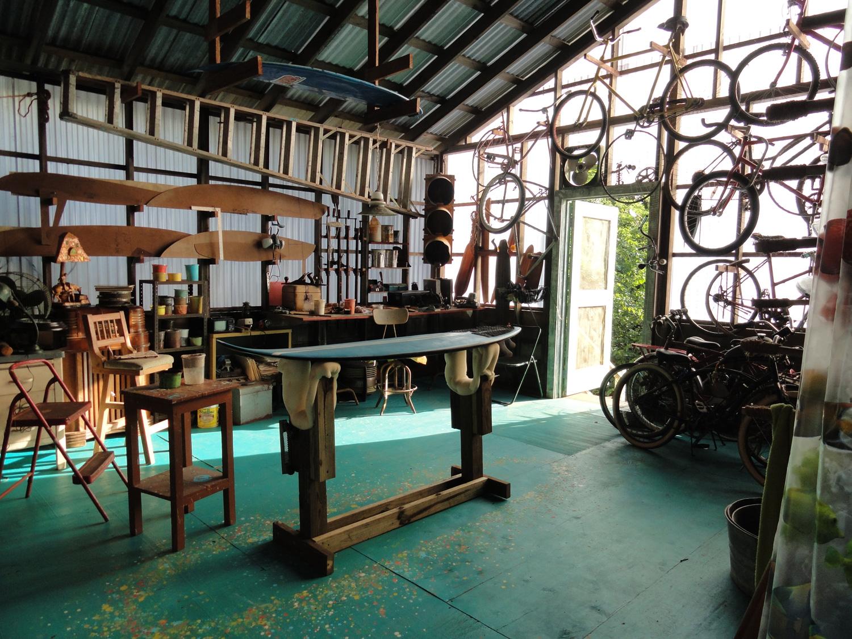 The workshop in Big Poppa's (Barry Bostwick) surf shop.
