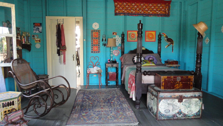 McKenzie's (Maia Mitchell) bedroom in Big Poppa's surf shop/house.