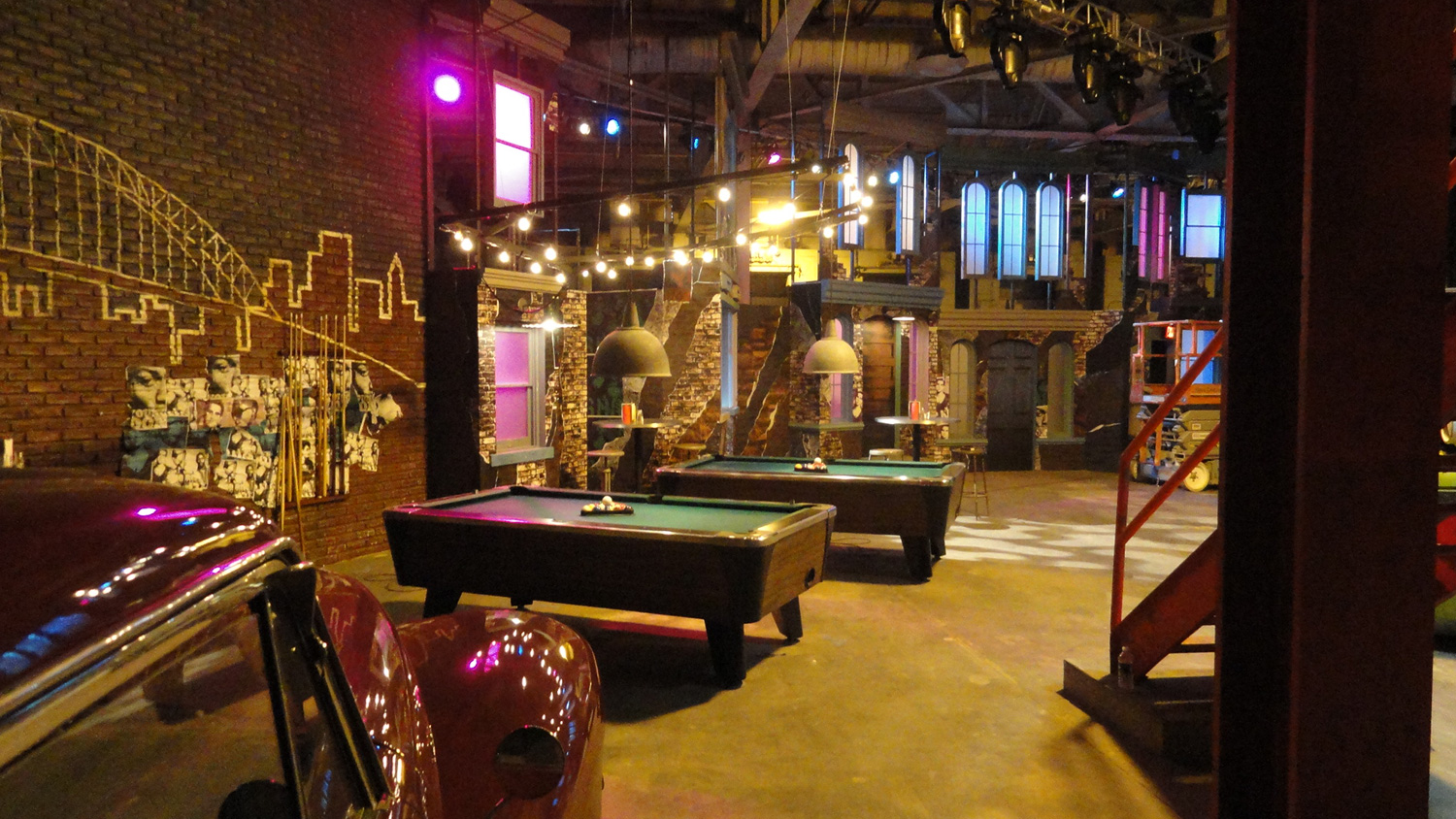 "A view of the pool table area taken from the ""Gas Station"" in club Off the Street."