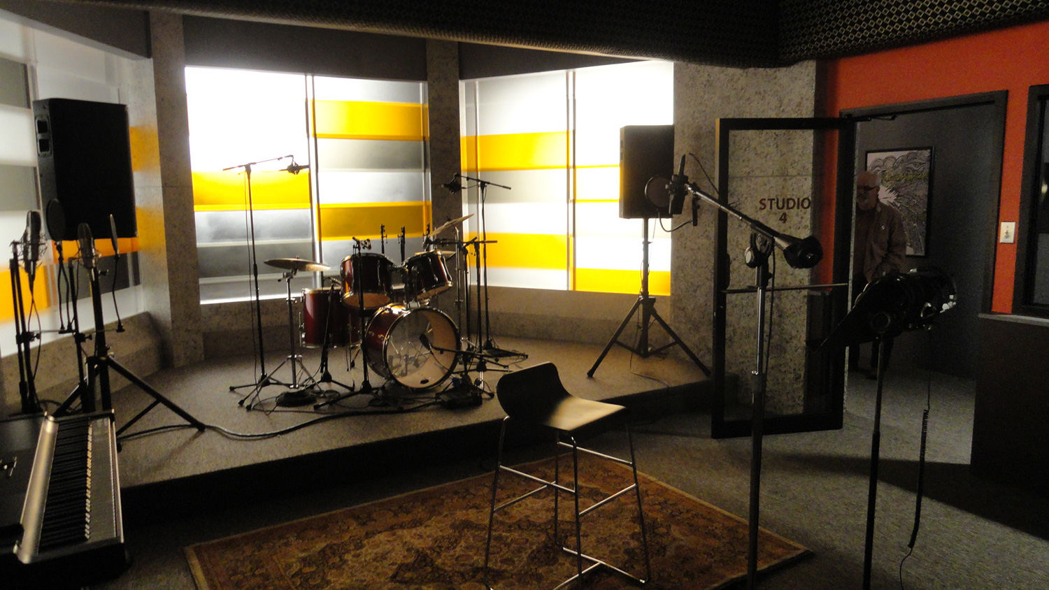 A detail of the session room with it's glowing backlit wall in the Atlanta Records recording studio set.