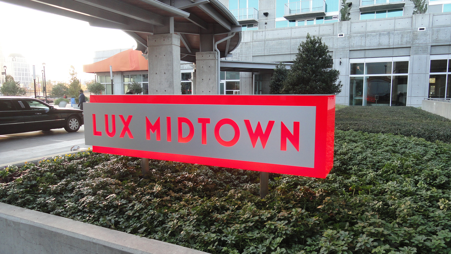 A lovely, glowing red sign we made for our fictional luxury hotel.
