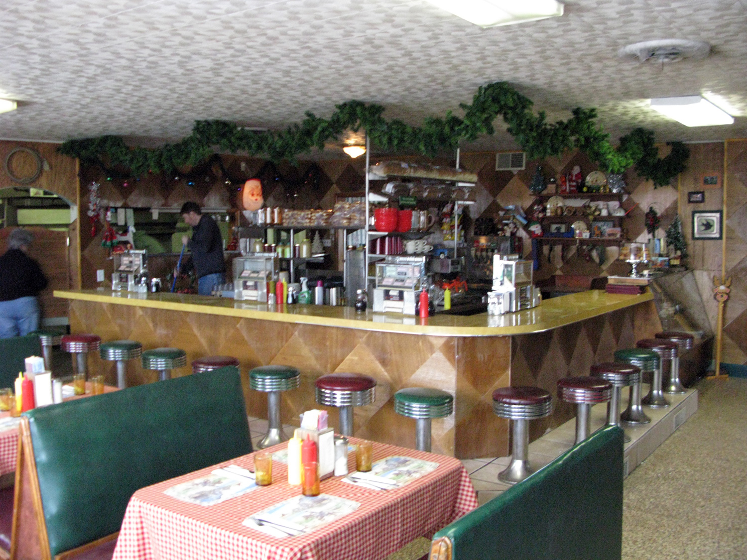 Classic American diner interior, done up for an over the top, Route 66 Christmas.
