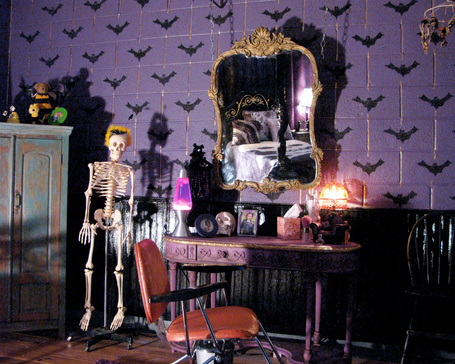Reverse of Goth Bumble bee scout's (Kelly Gould) bedroom ( she's really into Halloween, costumes and makeup)