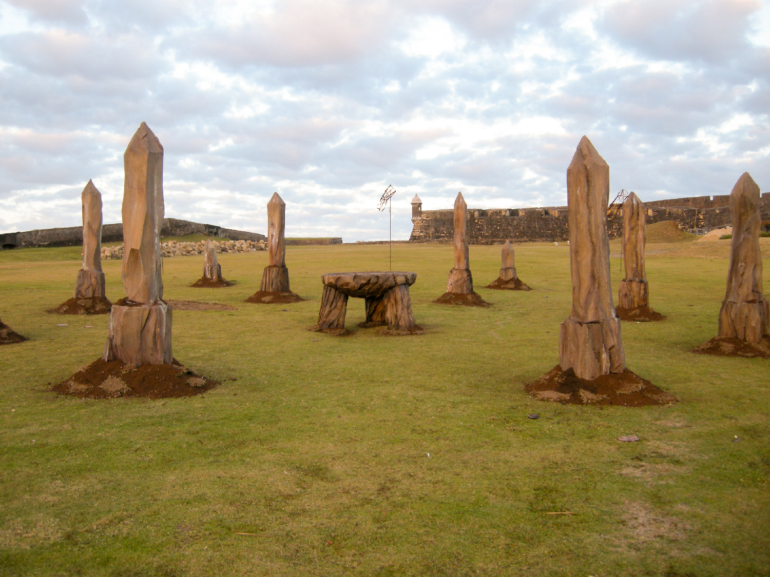 """""""Wizard Battle Field"""" We created these concentric rings of """"stone"""" obelisks and ribbon banners surrounding a three legged """"stone"""" table to create some visual landmarks in an otherwise vast empty space during a fast paced action and effects sequence."""