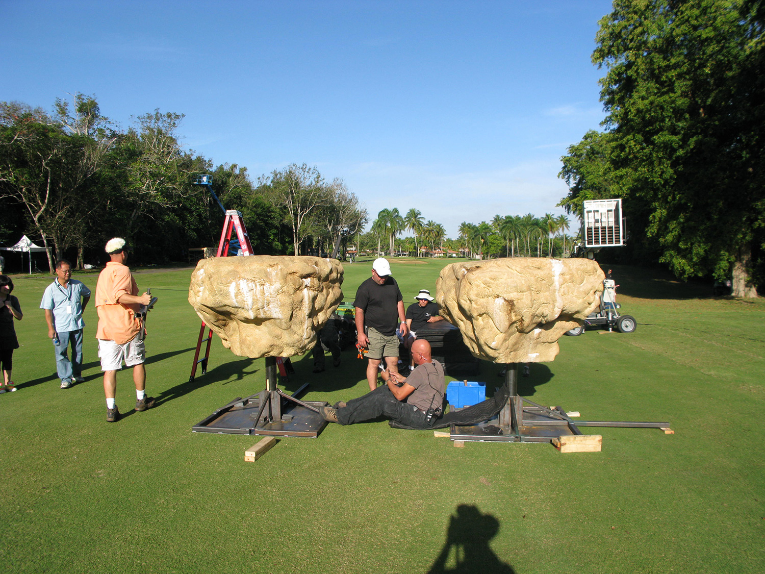 """""""Floating"""" stones, built on our efx crew's brilliant universal hydraulic gimbals, magically carried our hero's (David Henrie & Selena Gomez) across the yawning chasm. We actually used this golf course fairway as a natural green screen."""