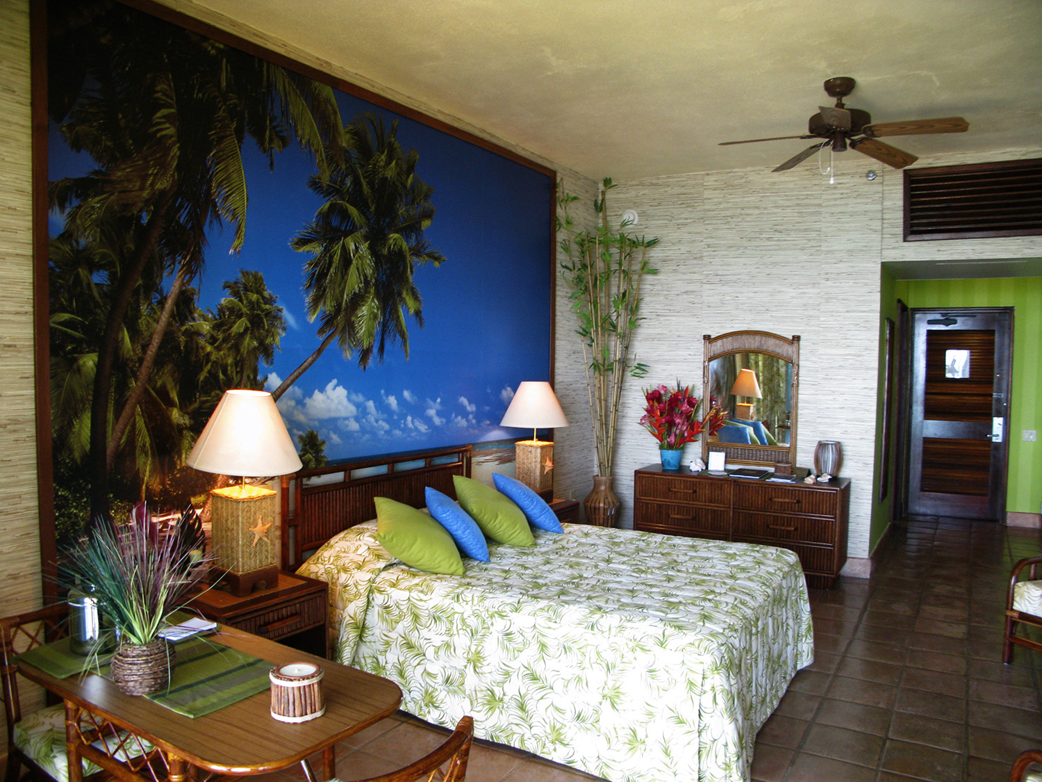 Tropical resort hotel room for Mr. and Mrs. Russo (David DeLuise & Maria Canals-Barrera).