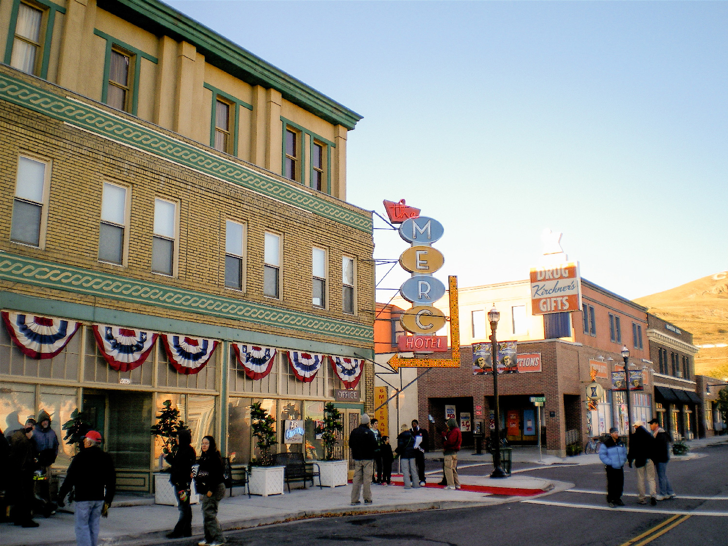 """Main street of a route-66-style fictional town """"Mercury"""". Here we added a third story, huge neon signage and facade details to the foreground """"Merc"""" hotel, and a second story and signage to the background drugstore in this shot."""