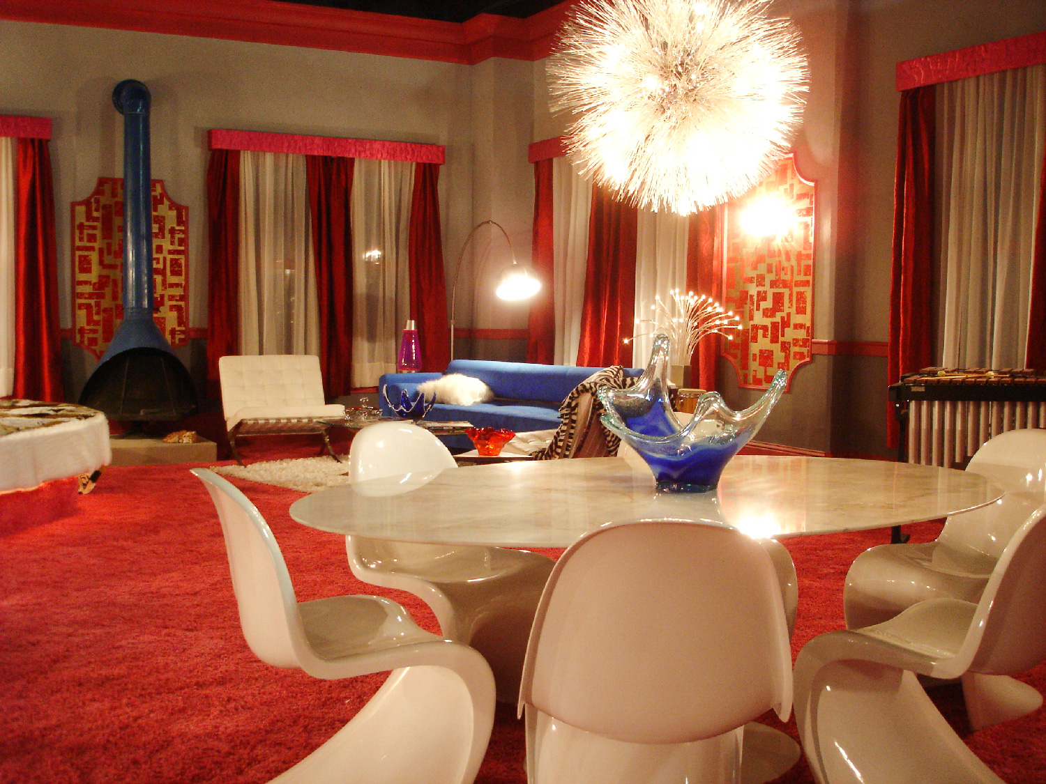 """Merv's (Jason Earles) Ratpack style swinging bachelor pad penthouse stage set on the top floor of the """"Merc"""" hotel."""