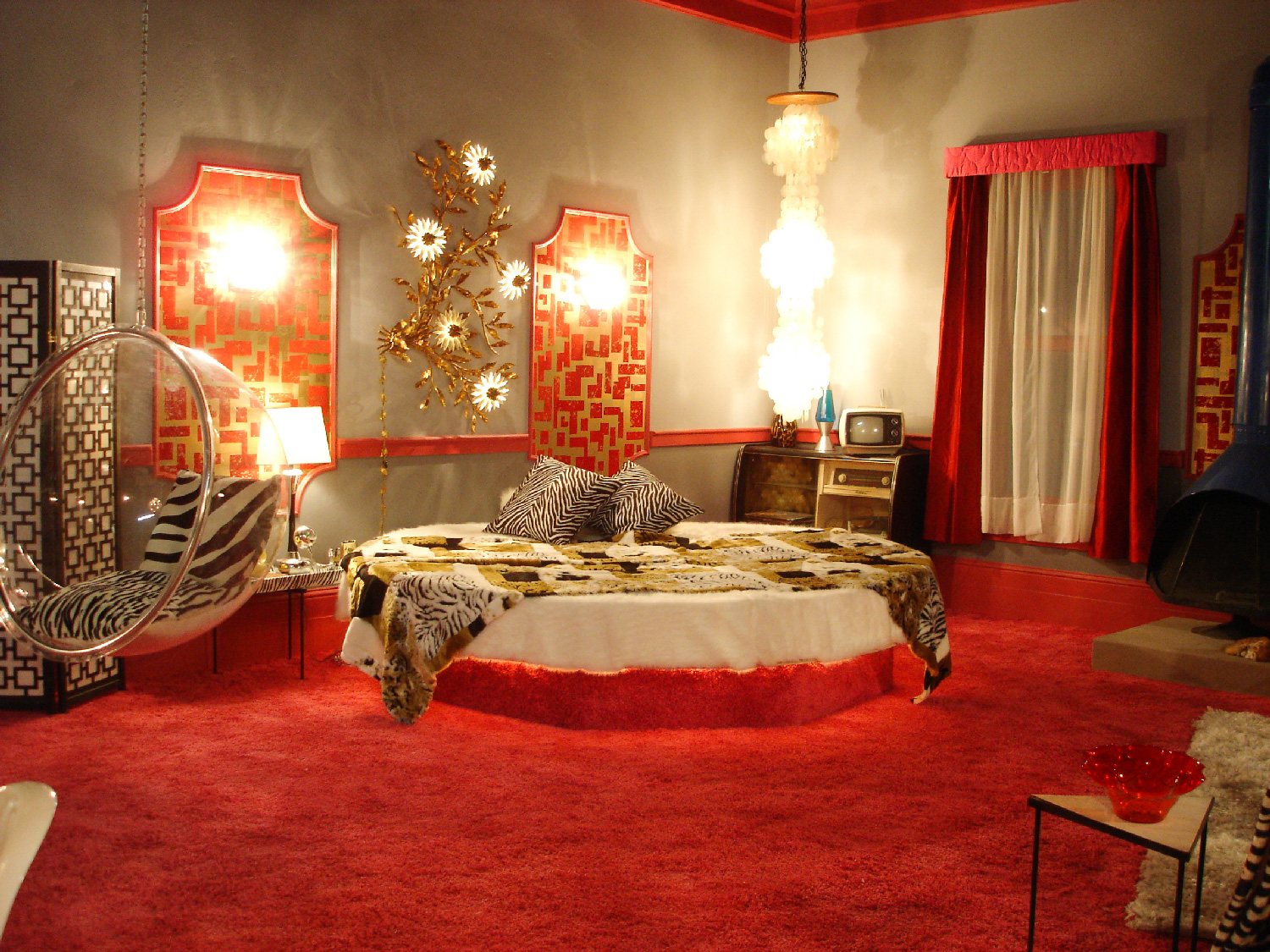 """View towards the circular bed in in Merv's (Jason Earles) Penthouse stage set on top of the """"Merc"""" hotel."""
