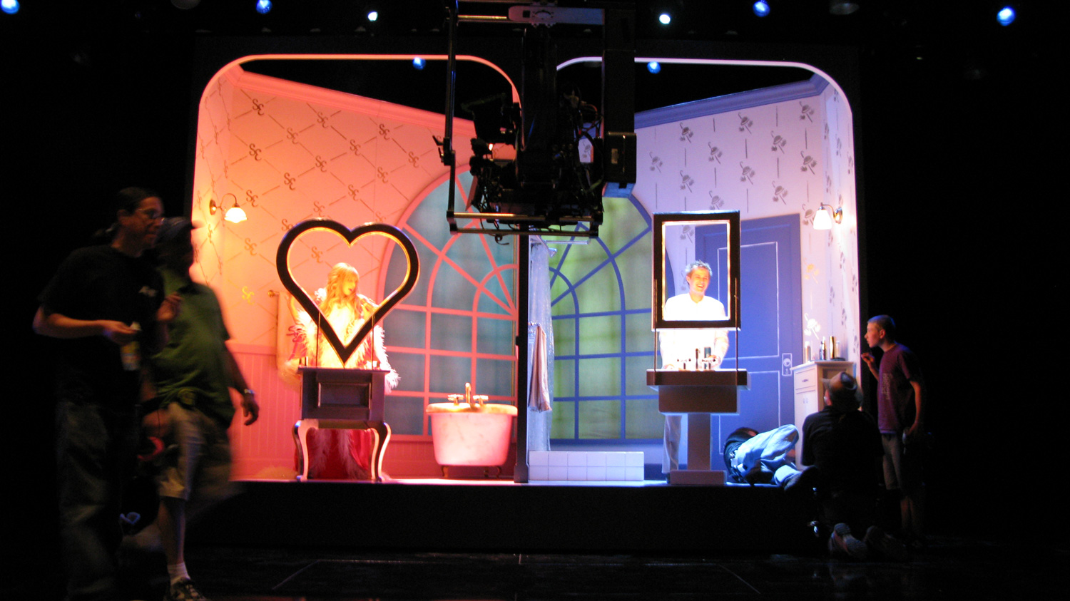 Sharpay (Ashley Tisdale) and Ryan (Lucas Grabeel) prepare for their big prom night in their split bathroom wagon set. The bathroom rolls away, and a curtain raises revealing a neighborhood.