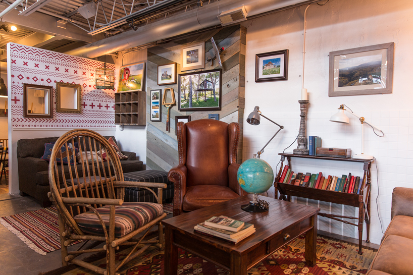 The comfortable, casual sitting area. Framed photos of some of Airbnb's many cool properties dot the walls among other nostalgic pieces of art.