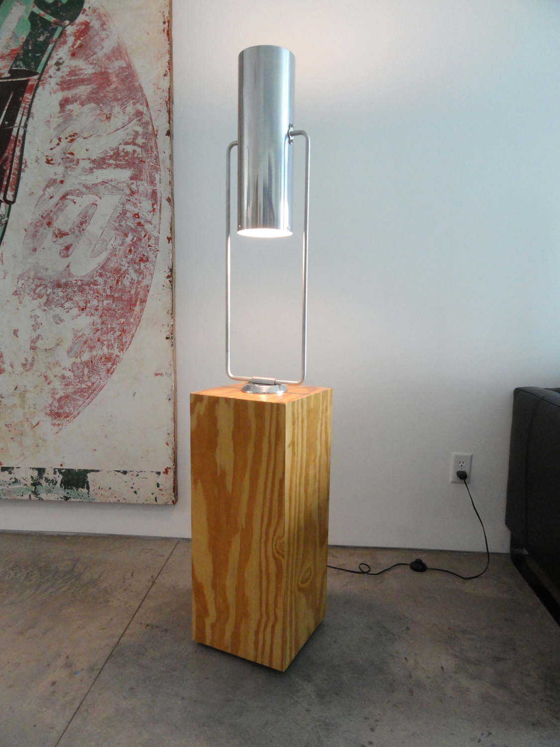 Floor lamp, made from a rectangular plywood base box and salvaged 1960's department store, ceiling-mounted light fixtures.