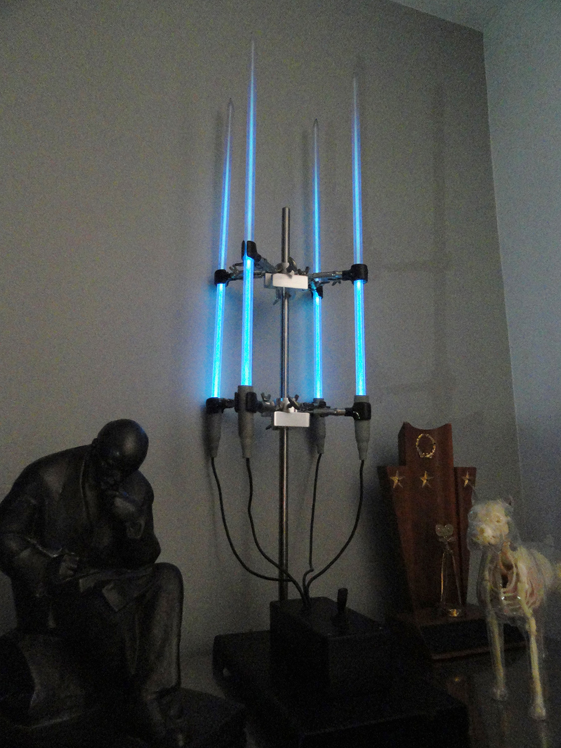 """Candelabra"" light, made from four strips of high-frequency neon and chemist's clamps."
