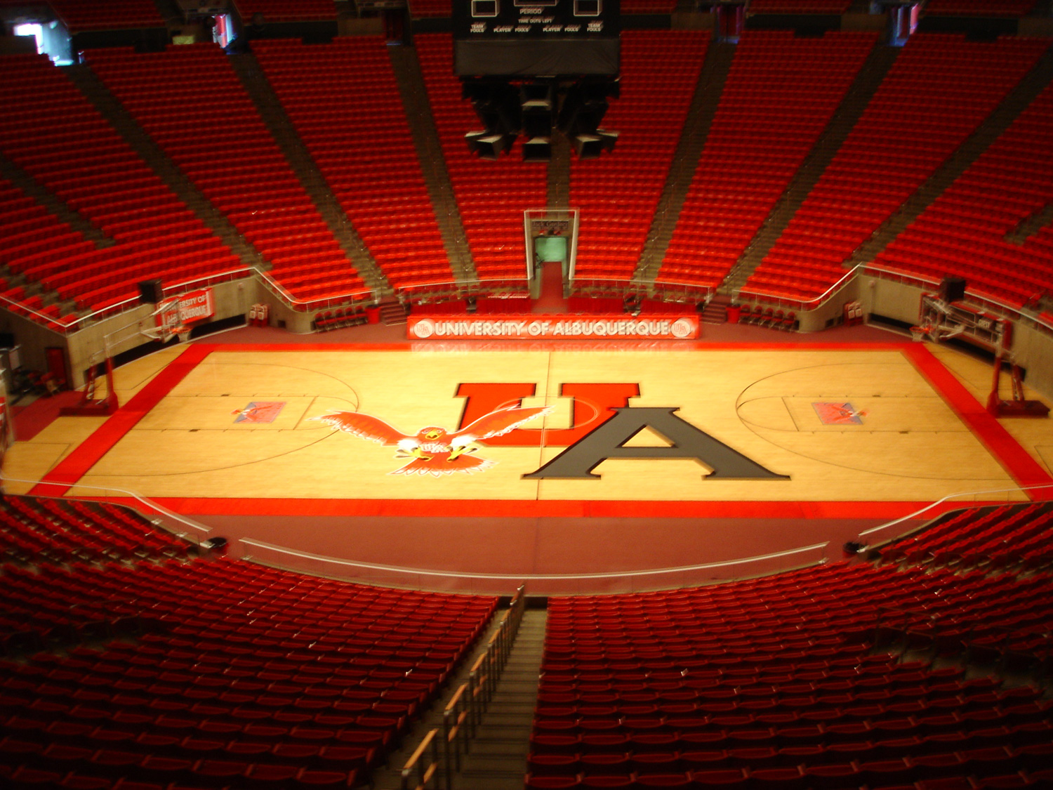 """Over-sized basketball floor graphics to create the """"University of Albuquerque""""."""